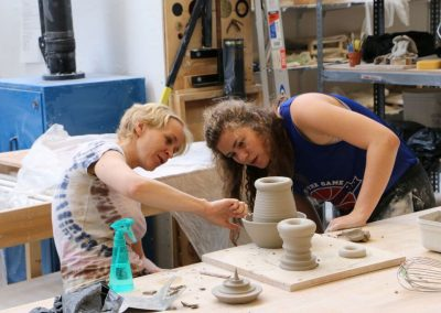 Ceramics faculty Gerit Grimm reviews a project with a student at the Art Lofts Ceramics lab.
