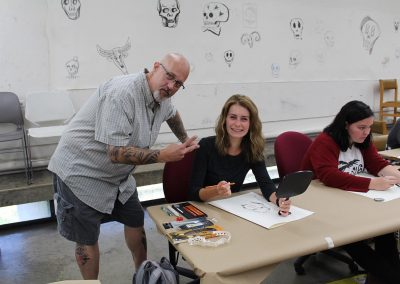 Art faculty Fred Stonehouse poses with a student in his Drawing class at the Mosse Humanities Building at the University of Wisconsin-Madison.