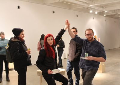 Grad student John Shea celebrates his MA Show with his peer Claire Wilson at the reception at Gallery 7.