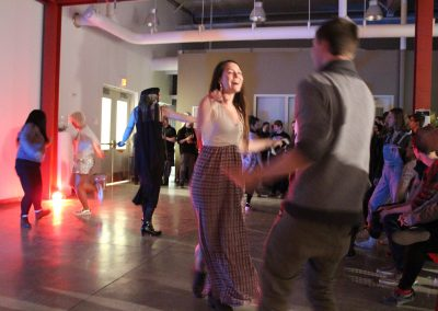 Visitors dance at Matt Mauk and Heather Sutherland's MFA Show Reception at Art Lofts, University of Wisconsin-Madison