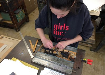 A student places movable type in a bed for a letterpress project during the Book Arts class taught by Jim Escalante at the Mosse Humanities Building at the University of Wisconsin-Madison.