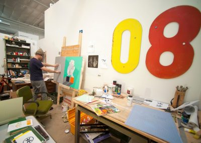 Graduate art student Eric Wold works on a painting in his studio in the Art Lofts building at the University of Wisconsin-Madison.