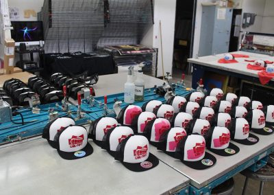 Customized trucker hats sit out to dry at the Serigraphy Lab at the Mosse Humanities Building at the University of Wisconsin-Madison.