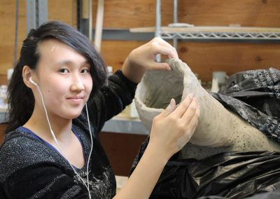 An undergraduate student works on a sculpture at the University of Wisconsin-Madison.
