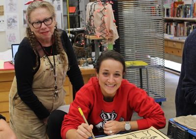 Art faculty Lynda Barry poses with a student in her Making Comics class at the Mosse Humanities Building at the University of Wisconsin-Madison.