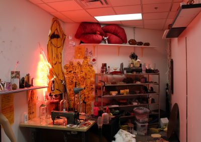 A view of a graduate studio with neon lighting in the Art Lofts.