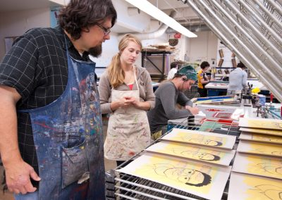 John Hitchcock reviews prints with a student in the serigraphy class in the George Mosse Humanities building at the University of Wisconsin-Madison.