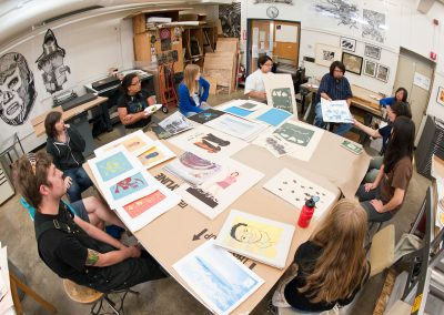 Students review their screenprinting projects in the Serigraphy class at the George Mosse Humanities Building.
