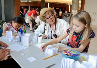"Lynda Barry leads a ""drawing jam"" with children during a Saturday Science outreach event at the University of Wisconsin-Madison."