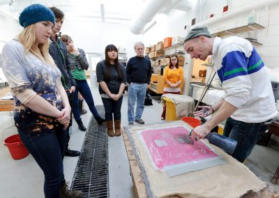 Michael Connor's digital printmaking class participates in a Combat Paper workshop, which transforms military uniforms into handmade paper, at the Art Lofts, University of Wisconsin-Madison.