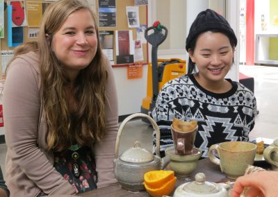 Students enjoy a tea party using handcrafted tea sets created in ceramics class at the Art Lofts Building at the University of Wisconsin-Madison.