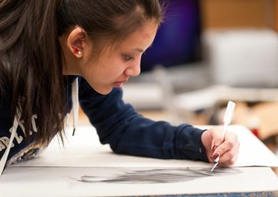 A student touches up their drawing on a lithography print at the Mosse Humanities Building at the University of Wisconsin-Madison.