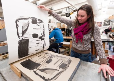 A student pulls a print off a lithography stone in Lithography class at the Mosse Humanities Building at the University of Wisconsin-Madison.