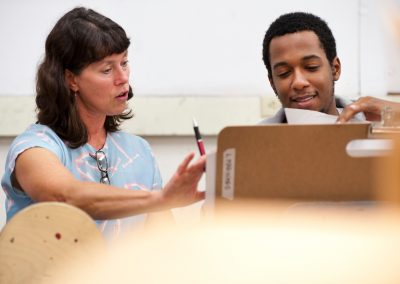 Art Faculty Gail Simpson mentors undergraduate Willie Sinclair about his sketch while teaching a foundations class in the Mosse Humanities Building at the University of Wisconsin-Madison.