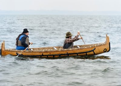 From back to front of canoe, Wayne Valliere, a Native American artist-in-residence with the Department of Art and member of the Lac du Flambeau Band of Lake Superior Chippewa Indians, and Tim Frandy, an outreach specialist at the UW Collaborative Center for Health Equity, take a traditional Ojibwe birchbark canoe for an inaugural paddle in Lake Mendota near the University of Wisconsin-Madison.  The canoe is known in Ojibwe language as wiigwaasi-jiimaan, and was handmade by Valliere as part of his residency.