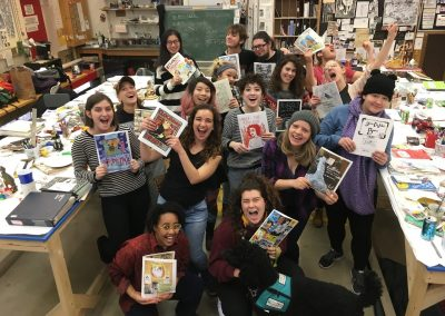 Lynda Barry's Art 448 Making Comics 1 students pose with their final project comics on the last day of class at the University of Wisconsin-Madison.