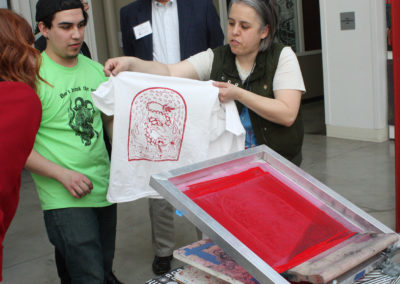 Fresh Hot Press Students pull a shirt printed with a design on the mobile serigraphy press at the Art Lofts building at the University of Wisconsin-Madison.