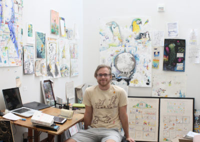 Graduate art student Will K. Santino poses with his work in his studio space in the Art Lofts building at the University of Wisconsin-Madison.