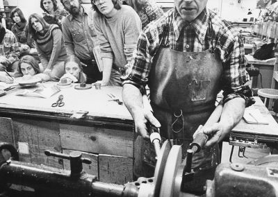 Professor Fred Fenster demonstrates metalworking techniques to his class. Fenster taught design, jewelry, and metalsmithing at the University from 1962 to 2004.