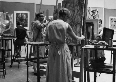 Art students create paintings in a studio in the 1950s.