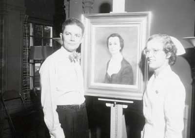 Robert Grilley poses with painting of Christina Murray, late director of UW School of Nursing. In 1942, Grilley received a Bachelor of Science degree, and in 1946 a Master of Fine Arts. He taught at the University of Wisconsin-Madison from 1945 to 1987.