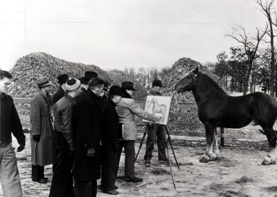 A group of students watch their instructor work on a sketch of a draft horse, ca. 1939.