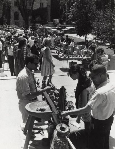 Pedestrians browse art for sale at the 1969 Library Mall Art Fair.