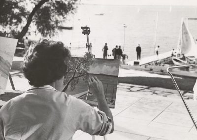 A student artist paints a view of Lake Mendota from the Memorial Union Terrace in 1963.