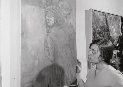 Sylvia Salachek stands by her artwork which made her the Capital Times winner in the 32nd annual Student Art Show, ca. 1960.