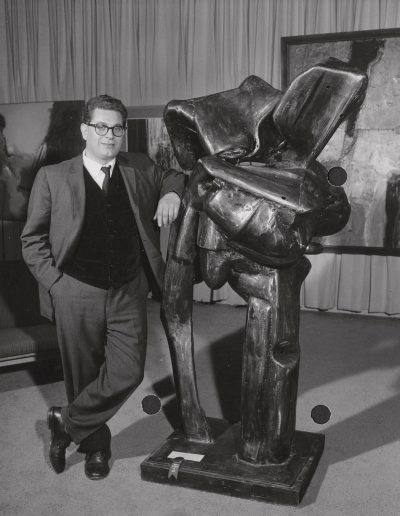 Italo Scanga stands by his sculpture for the art show at the Memorial Union, ca. 1961. Scanga taught at the University of Wisconsin-Madison from 1961 to 1964.
