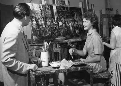 Art student Mary Kassner working on a painting, ca. 1958.