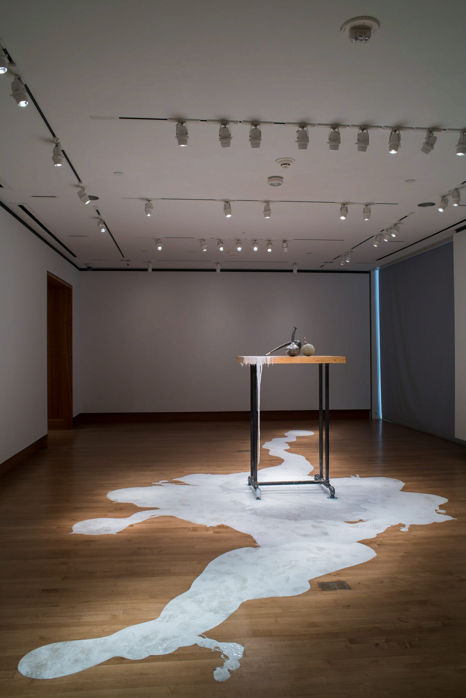 """Labware,"" 2018-2019, Pewter, copper, magnifying lens, silicone. Metalsmithing installation art from Chloe Darke's Master of Fine Arts exhibition Secrete, Augment, Testify at the Chazen Museum of Art, University of Wisconsin-Madison. Photography by Kyle Herrera."
