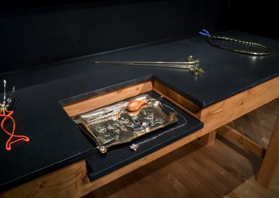 """Cordyceps Extraction Kit,"" ""Dilate,"" ""Shear,"" and ""Clamp"" metalsmithing and silversmithing art from Chloe Darke's Master of Fine Arts exhibition Secrete, Augment, Testify at the Chazen Museum of Art, University of Wisconsin-Madison. Photography by Kyle Herrera."
