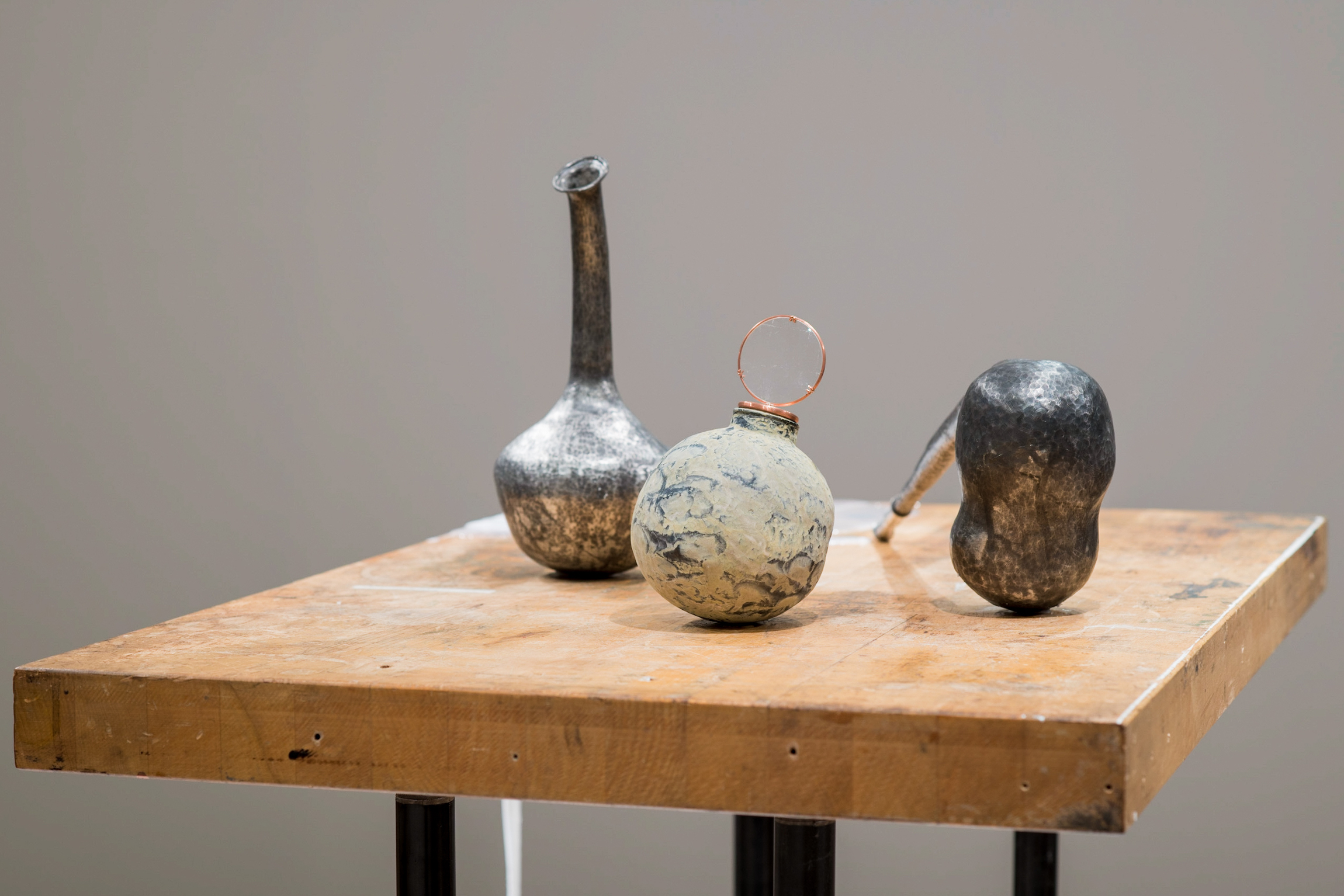 """Labware,"" 2018-2019, Pewter, copper, magnifying lens, silicone. Metalsmithing art from Chloe Darke's Master of Fine Arts exhibition Secrete, Augment, Testify at the Chazen Museum of Art, University of Wisconsin-Madison. Photography by Kyle Herrera."