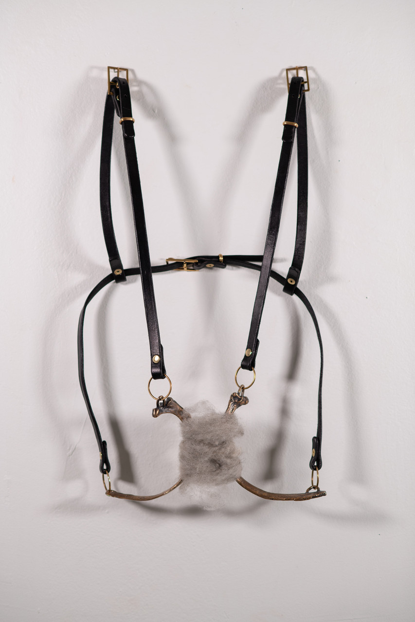 Milk-Stealing Harness, Bronze, brass, leather, raw wool art metals sculpture by Cate Richards.