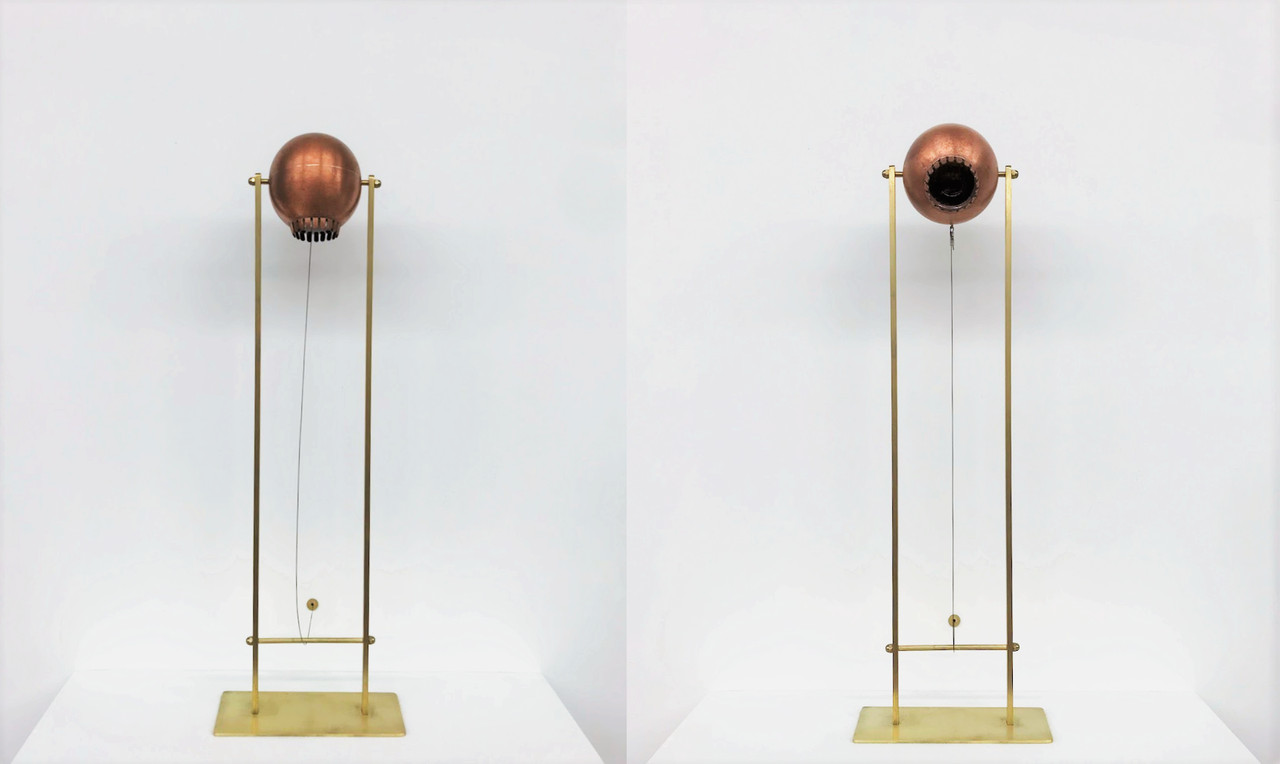 Endling, copper, brass, lens, electronics, sensor-Animatronic eyeball by Stacy Lynne Motte. The Endling eyeball senses motion. Every time someone passes, the eyeball quickly looks up, maintaining eye contact for 20 seconds, before losing interest and slowly ticking back down into position.