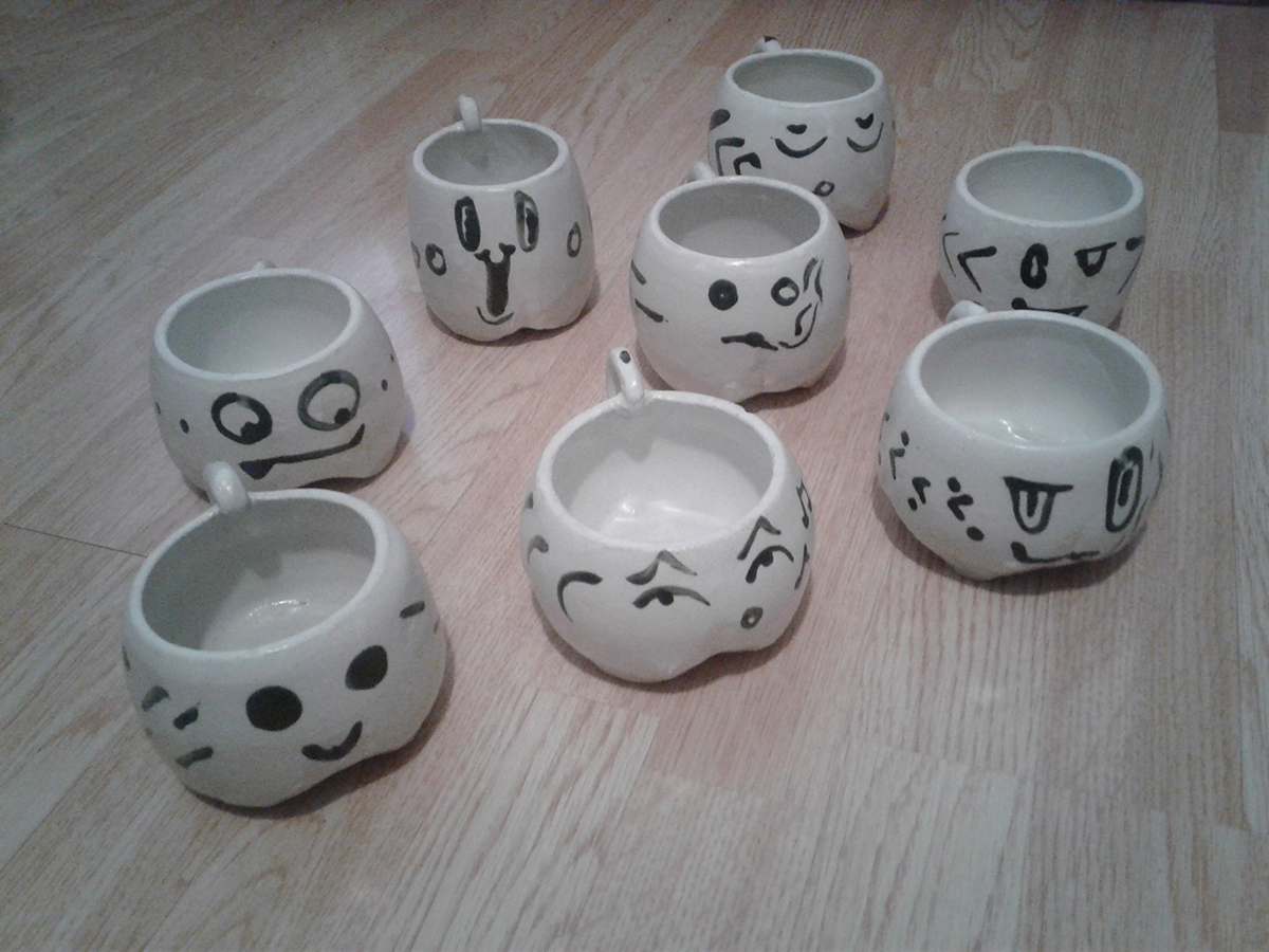 Faces of the Day, clay ceramic cups by Abby Louise Showers.