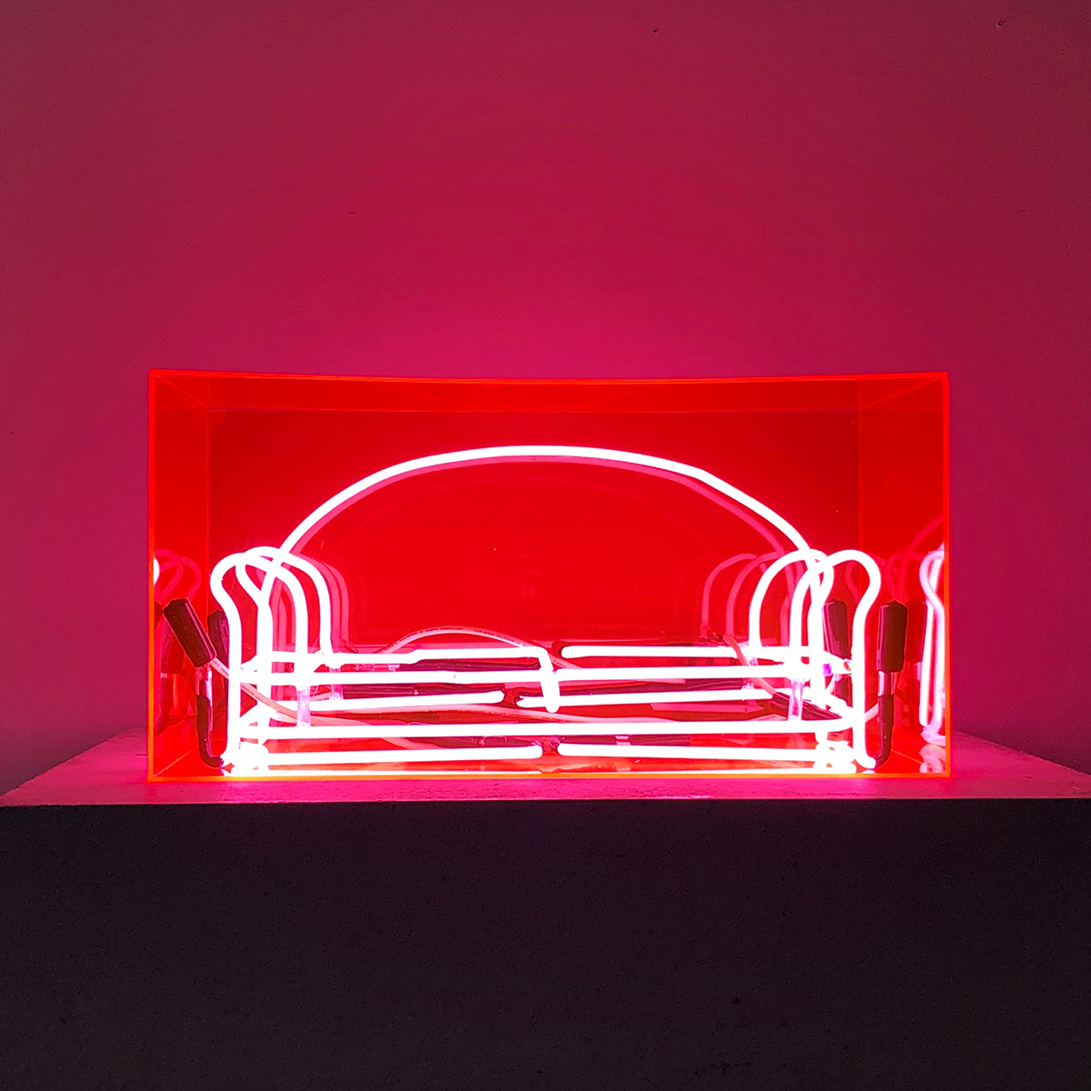 Couch, neon and acrylic box art by Isabel Monti.