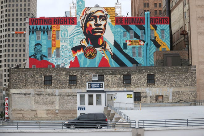 New mural by Obama 'Hope' poster artist sends message about 'Voting Rights' in Milwaukee by Chelsey Lewis
