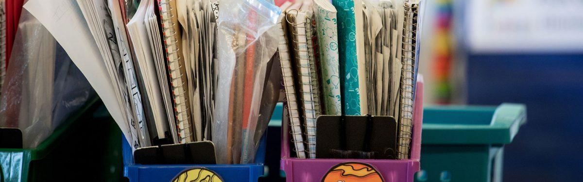 Notebooks in bins