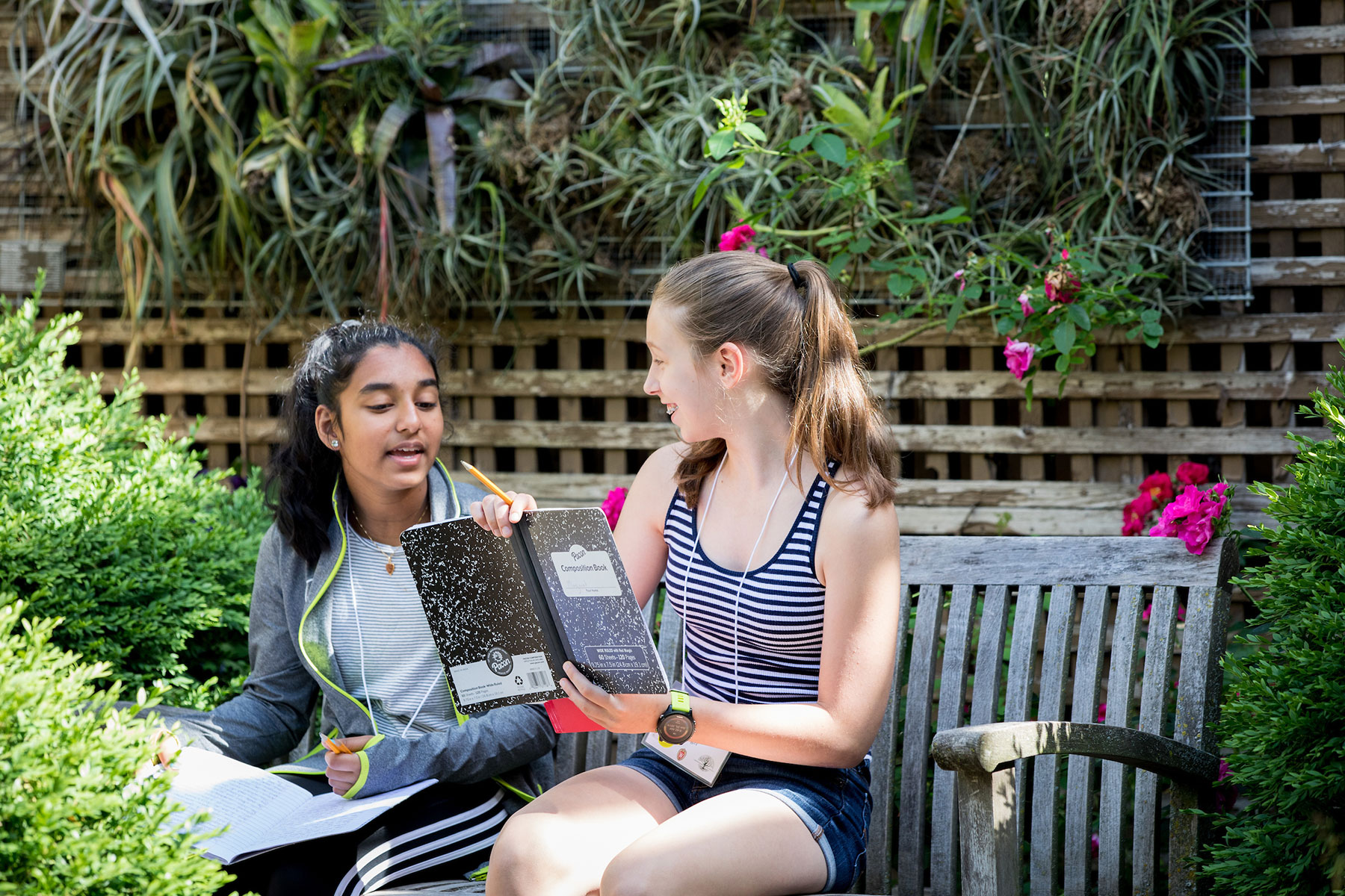 Two participants in the high school writers camp discuss