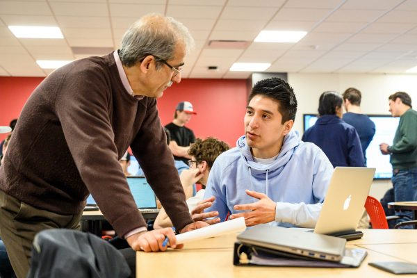 A student and instructor engaged in conversation
