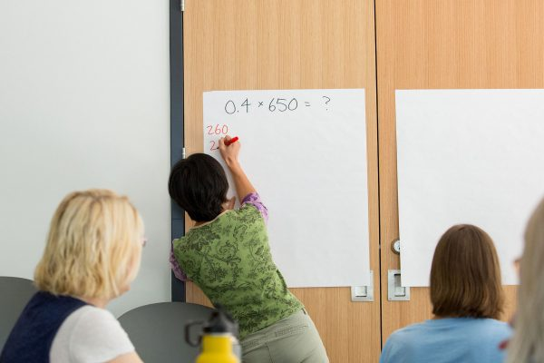 UW–Madison Assistant Professor Nicole Louis leads a number talk at the Math Equity Project