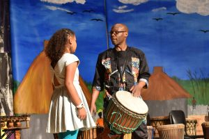 Yorel Lashley instructing a student on drumming