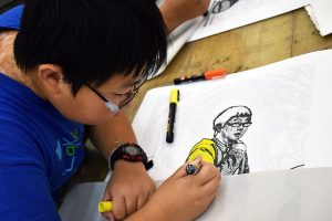 Student drawing in FauHaus workshop