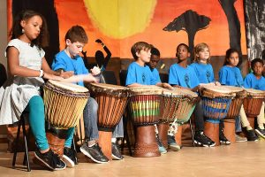 Students on stage performing during African night