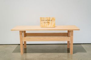 Wood table and wooden sign made during the woodworking class of Summer Arts Studio