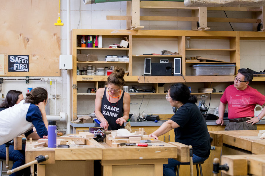Sylvie Rosenthal teaching students in her wood working class during Summer Arts Studio