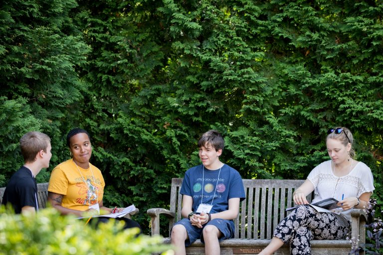 Four students discussing at highschool writers camp