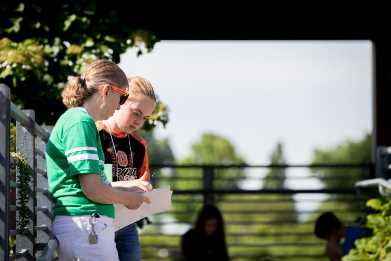 A student discusses with her mentor